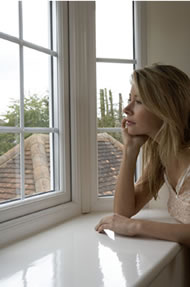 Woman looking out through a Deceuninck Upvc Window